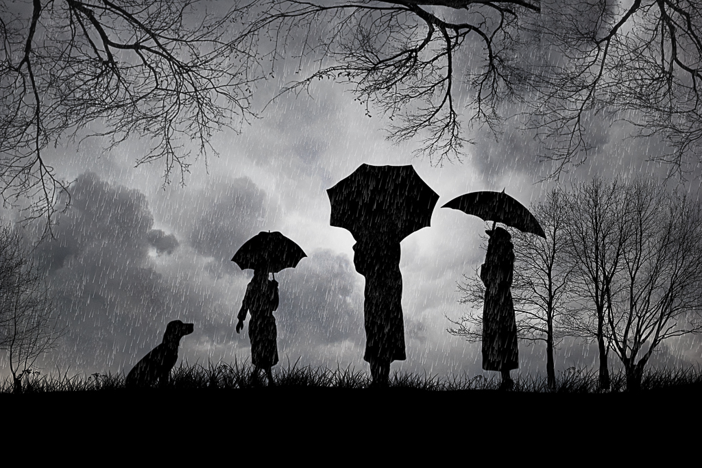 Siluetas con paraguas
